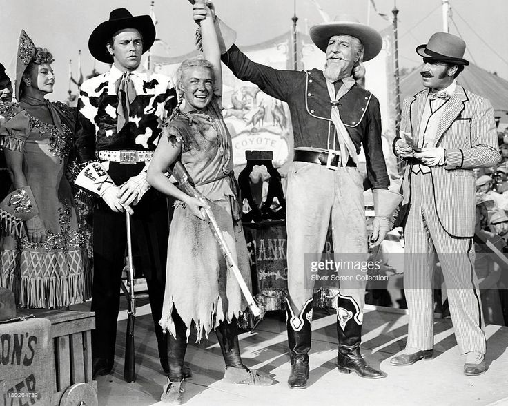Benay Venuta as Dolly Tate, Howard Keel as Frank Butler, Betty Hutton as Annie Oakley, Louis Calhern as Buffalo Bill Cody and Keenan Wynn as Charlie Davenport, in 'Annie Get Your Gun', directed by George Sidney, 1950.