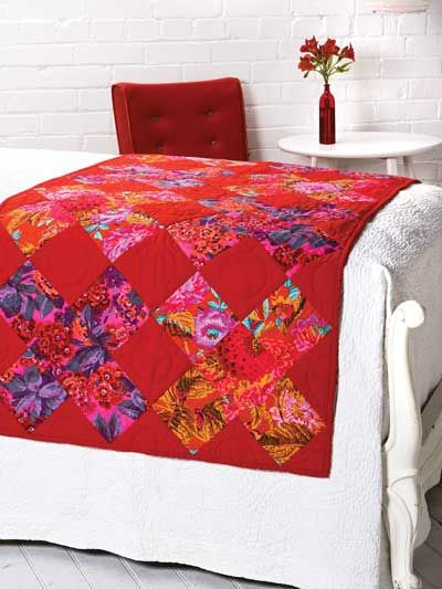 Now I know what to do with my large Kaffe Fassett fabrics I don't want to cut up!! I love that the fabrics are being showcased in large blocks and that they almost disappear into the bright red background. This quilt is just lovely!