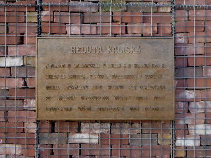 """Reduta Kaliska - this memorial in a small square at the intersection of Kaliska and Grójecka streets commemorates the Polish partisans who defended the so-called """"Kalisz stronghold"""" in the Ochota district during the Warsaw Uprising of 1944...."""
