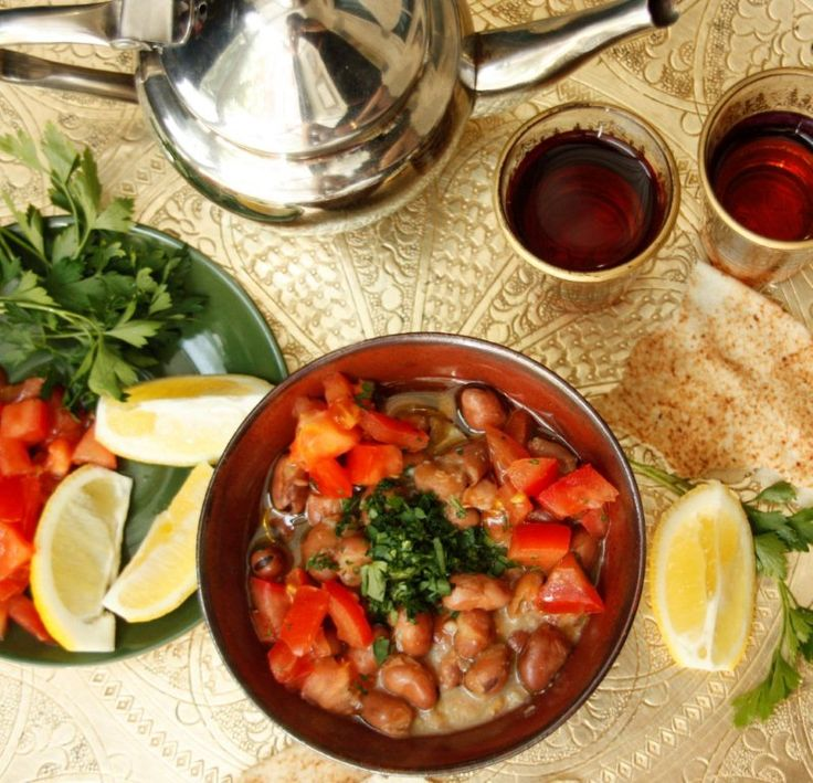 Egyptian-style Ful/canned fava beans.  with cumin, lemon, tomato, olive oil, parlsey