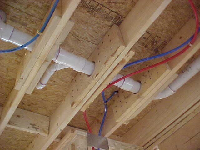 "One solution is to apply ""sister"" joists on either side like in the photo below, but to pass inspection you'll need to show calculations from a structural engineer that verify it's OK. Description from askmehelpdesk.com. I searched for this on bing.com/images"