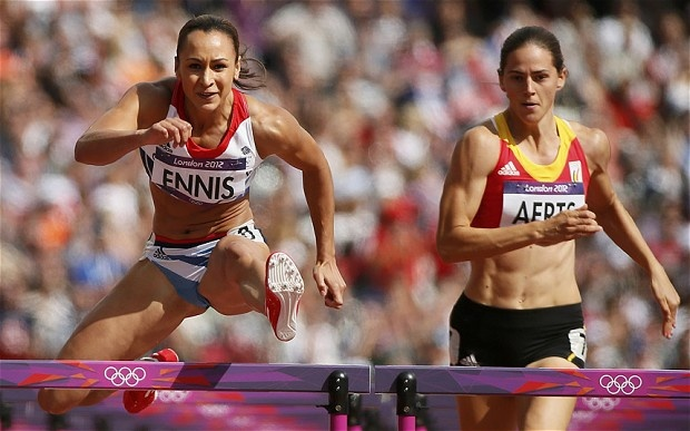 Britain's Jennifer Ennis and Belgium's Sara Aerts compete in their women's heptathlon 100m hurdles heat during the London 2012 Olympic Games