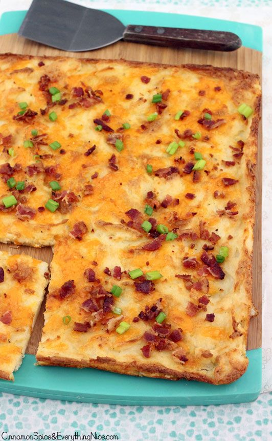 """Loaded Potato Crunch~~2.5# russet potatoes 4 T butter 1/2 C milk sea salt & pepper  1 1/2C shred sharp cheddar 4 slices crumbled bacon 2 green onions~~Cook potatoes. Drain & cook off excess water. Remove from heat. Add butter, milk, S&P &  mash. Mix in 3/4C cheddar.  400F. Grease 15x10"""" baking sheet with olive oil, Spread potatoes. Sprinkle remaining cheese on top.Bake 40-45 min until bottom & edges are browned & crispy. Sprinkle bacon & onions on top. Cut  into squares. Top with sour cream."""