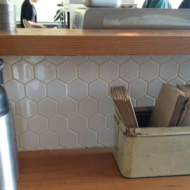 Large white hexagonal tile backsplash