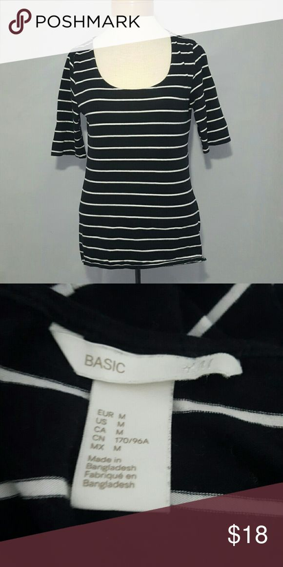 H&M Black & White Striped Stretchy Boat Neck Top Good condition just slightly faded. Stretchy and comfy. 3/4 sleeve. H&M Tops