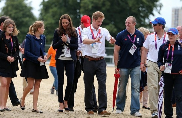 Members of the British Royal family from left to right: Princess Eugenie, Princess Beatrice, Kate Middleton the Duchess of Cambridge, Prince Harry, Mike Tindall, husband of competitor Zara Phillips, and Peter and Autumn Phillips chat after Britain's Zara Phillips won a silver Medal in the equestrian team eventing at the 2012 Summer Olympics at Greenwich Park, in London on Tuesday, July 31, 2012.