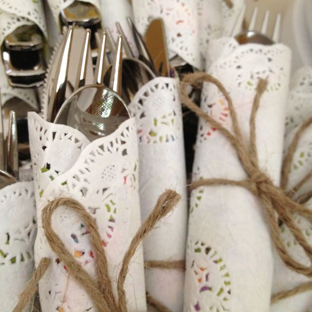 Silverware wrapped with doilies & twine. Would also be great with Christmas ribbons.