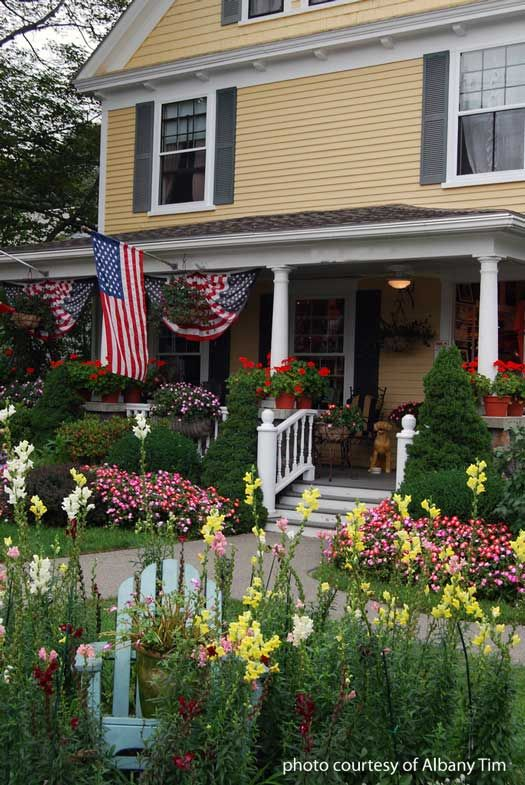 forget the link. i like the house. it looks like the firefly inn from gilmore girls.   Patriotic pictures, Patriotic photos, 4th of July decorations