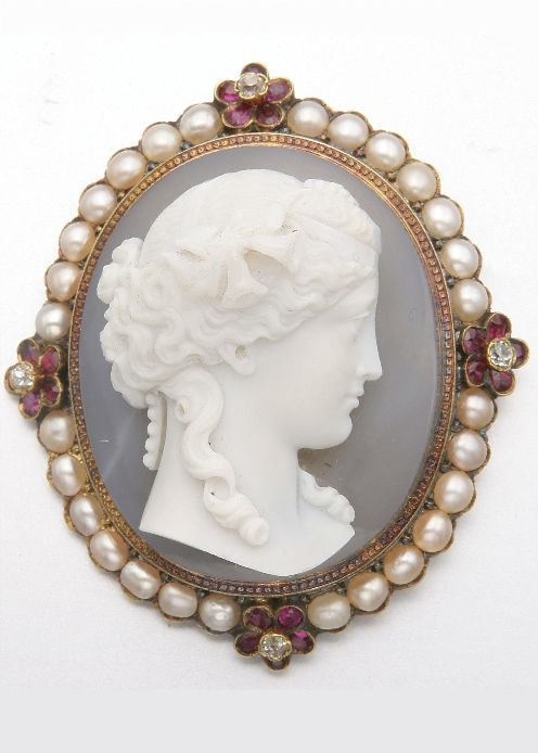 GOLD, HARDSTONE CAMEO, PEARL, RUBY AND DIAMOND BROOCH, MID-19TH CENTURY.