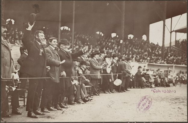 "AT THE BALLPARK 1903: Boston of the American League has a devout and influential supporters group, known as the ""Royal Rooters."" The march into the stadium singing, cheer loudly, and follow the beats of their drummer and sing the song ""Tessie."" [still]"
