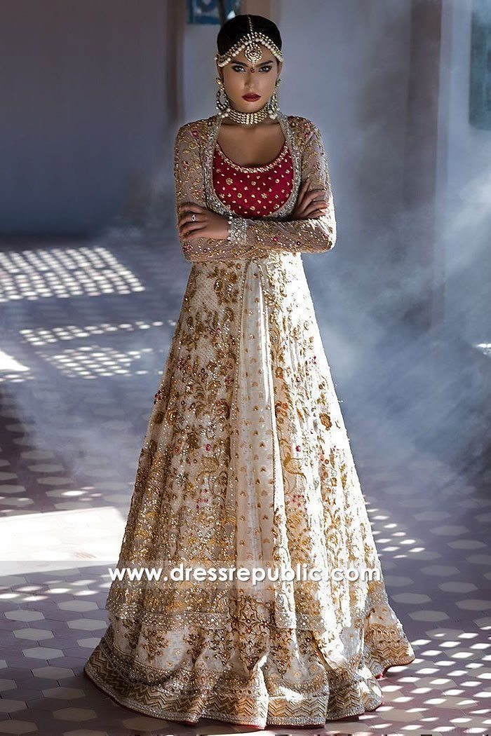 Minus the angry looking indian wedding dress model, this indian wedding gown looks amazingly modern. Red and beige indian wedding gown with long sleeves creates a traditional yet modern feel #indianweddingdresses #redweddingdresses #indianweddings