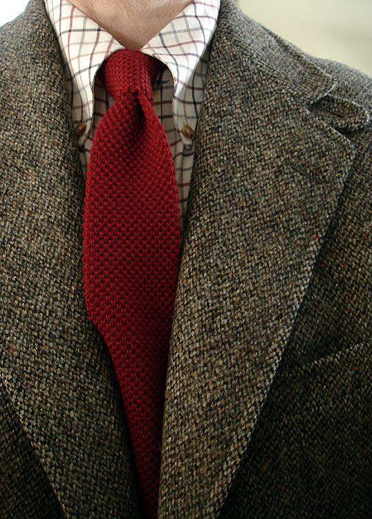 Grey tweed jacket, cream tattersall shirt, red knit tie