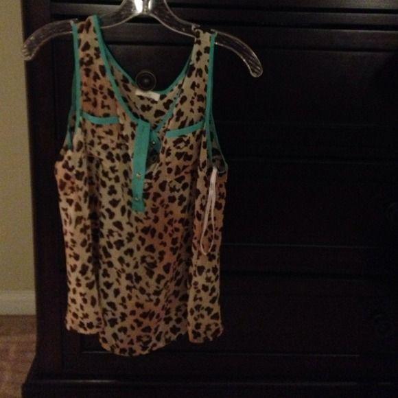 Cheetah print shirt Cheetah print shirt never worn edge Tops