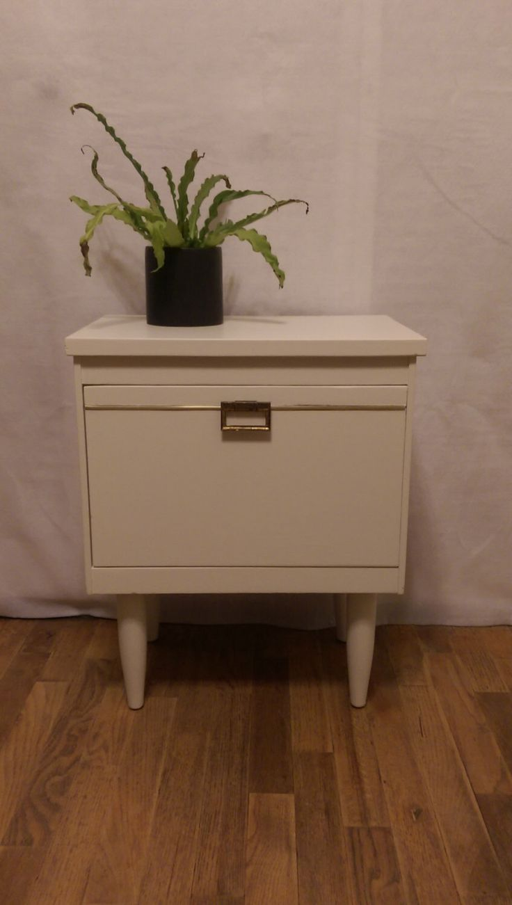 White MCM Side Table with Drawer by SkieShop on Etsy https://www.etsy.com/listing/244433791/white-mcm-side-table-with-drawer