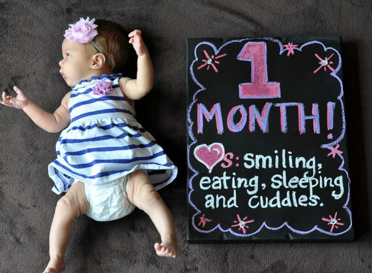 Baby girl's one month picture.