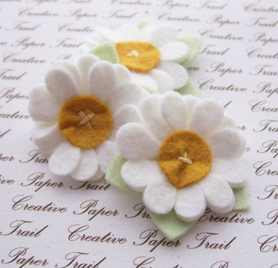 White Wool Felt Flowers. So cute. I can do this with my BigShot die machine and a little floss.