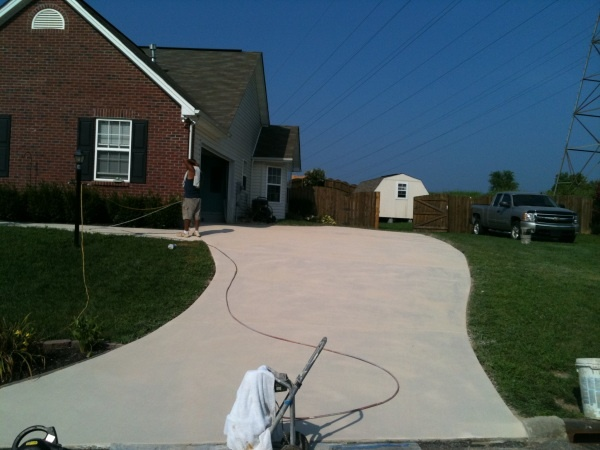 Concrete driveway resurfacing with Antique White broom finish and  Antique white sealer