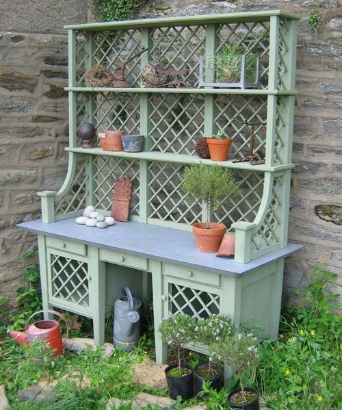 Love the shelves on this potting bench, also the color!