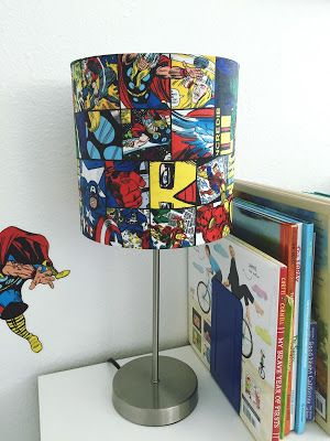 Avengers-Themed Kid's Bedroom Decor (With DIY Touches). DIY decoupage Avengers comic book lampshade. Click or visit FabEveryday.com to see details on the DIY projects and links to purchase the Iron Man, Captain America, and Avengers boys room decor.