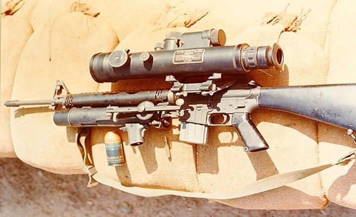 This fully rigged and modified M16 rifle was issued to U.S. Air Force Security Police at Tan Son Nhut Airbase for perimeter patrols. It features an attached AN/PVS-1 Starlight Scope and an XM148 grenade launcher.