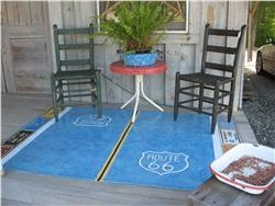 Route 66 designed floorcloth by  artist Angie Nelson. This original design is protected by copyright and certificate from the artist. Not only is the highway depicted, there are 8 license plates of the states Route 66 passes through