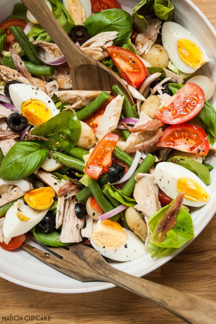 Everything you need to create the ultimate authentic Salad Nicoise - fresh tuna, anchovies, capers, egg, tomato, basil, green leaves, red onion, black olives
