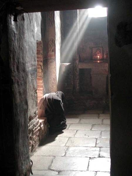 Nun praying at Gracanica Monastery, Serbia