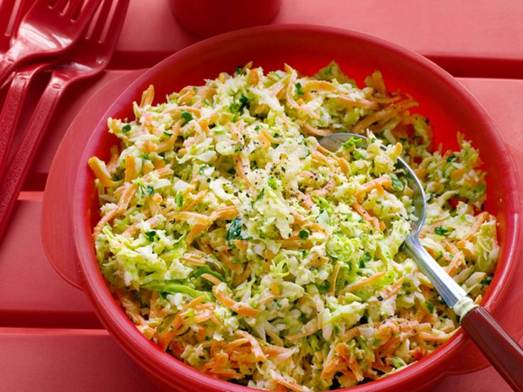 The Neelys' Sweet and Spicy Coleslaw : The Neelys give their coleslaw a sweet twang with apple cider vinegar and add a little spice with cayenne pepper.