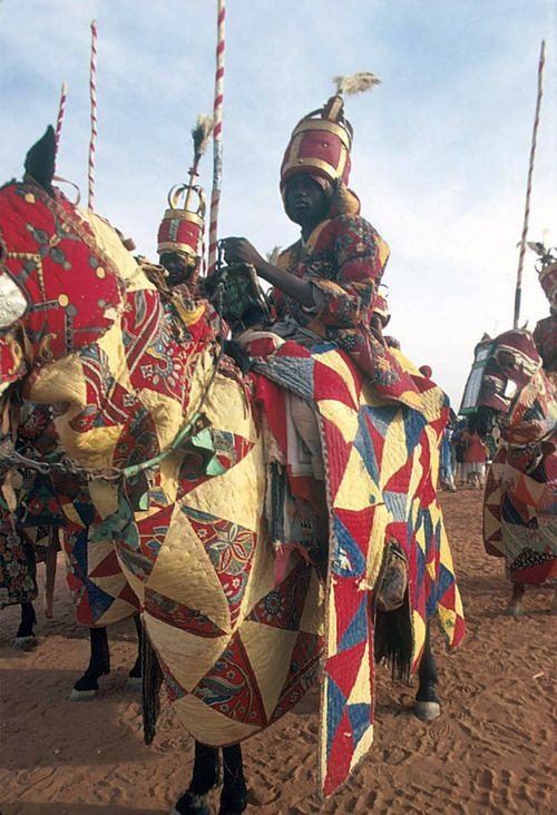 Africa  Hausa armed horsemen in quilted armour during 10th anniversary of independence celebration, Niamey, Niger  ©Eliot Elisofon. 1971.