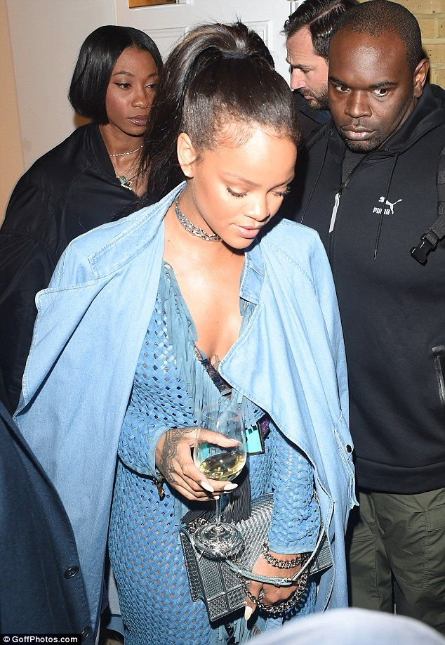 Funky look: The Barbadian beauty showed off her lacy black bra as she stepped out in a blue basket weave wraparound outfit that gave hints of bare skin