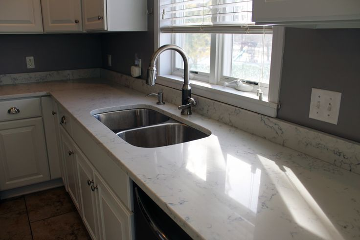Carrara White Quartz by Aggranite; 502A sink by Midwest