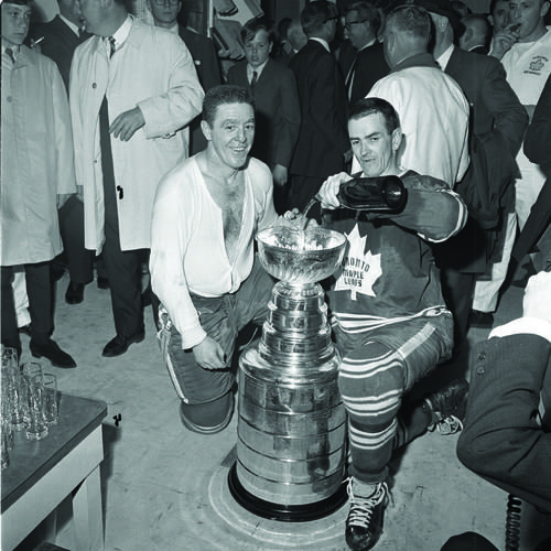 Marcel Pronovost watches as Dave Keon pours champagne in the Stanley Cup. (1967)