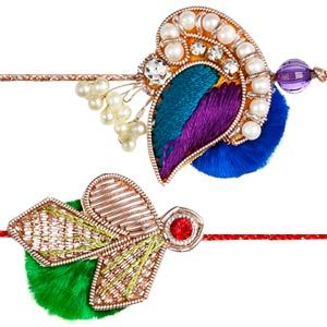 Zardozi Rakhi - Set of 2: This splendid pair of rakhis are smartly made using zardozi, diamonds, colorful stones and dangling pearls neatly hand-woven with thread to give these rakhis a colorful look. Costs Rs 416/- http://www.tajonline.com/rakhi-gifts/product/rdr64/zardozi-rakhi-set-of-2/?aff=pinterest2013/