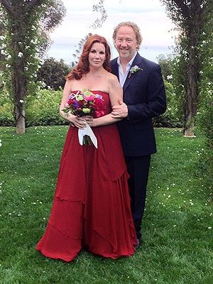 Melissa Gilbert married Timothy Busfield on April 24, 2013 at San Ysidro Ranch in Santa Barbara, CA. wearing a red strapless wedding gown, featuring a fitted bodice and a softly draped, tiered skirt. She found it at Morgane Le Fay in Santa Monica.