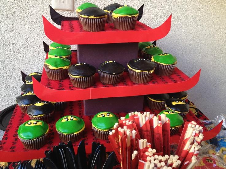 Ninjago Cupcakes (green & black ninjas) using marshmallow fondant over yellow icing