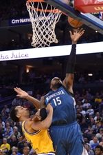 Minnesota Timberwolves forward Shabazz Muhammad (15) shoots the basketball against Golden State Warriors guard Shaun Livingston (34) during the second quarter at Oracle Arena.  #9232940