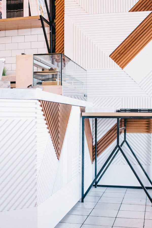 geometric wood installation at Juice Served Here / Bells & Whistles
