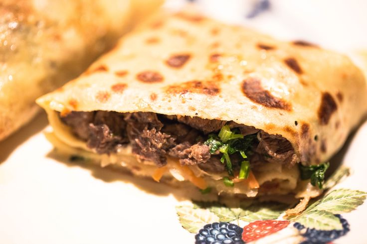 Ingredients:  Crepes, you can find the recipe here Crepes with Strawberry sauce and Ice-Cream.  Steak- 200 g, cut in small pieces.  Cilantro- 1/2 cup.  Onion- 1 medium, chopped.  Parmesan- 1/2 cup.  Sour cabbage- 1/2 cup.  Salt, pepper.  Oil.  Directions:  Heat an oven to 200C/390F. Line a baking tray with a foil paper.  Heat an oil in a frying pan, add chopped onion and cook till fragrant, add steak, season with salt and pepper, cook until meat turns white. Stir in cilantro , set aside…