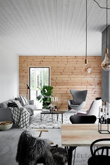 Ah.. this home in Finland is a stunner! The home is designed by Jonna Kivilahti for a young couple and I think it's absolutely perfect. The wooden plank walls give the home a slight cabin feel (but in