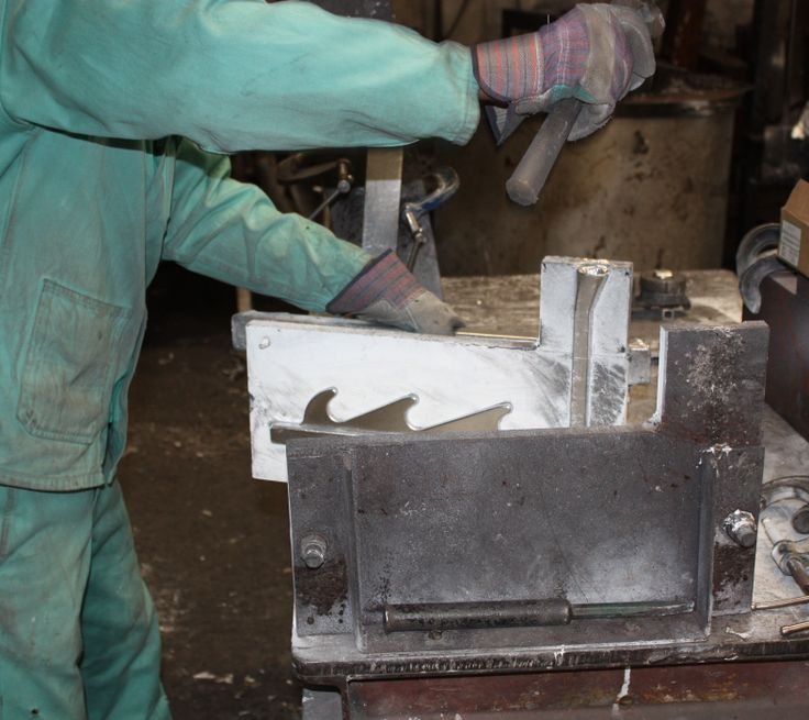 One of our craftsmen taking a piece of aluminium out of a cast.