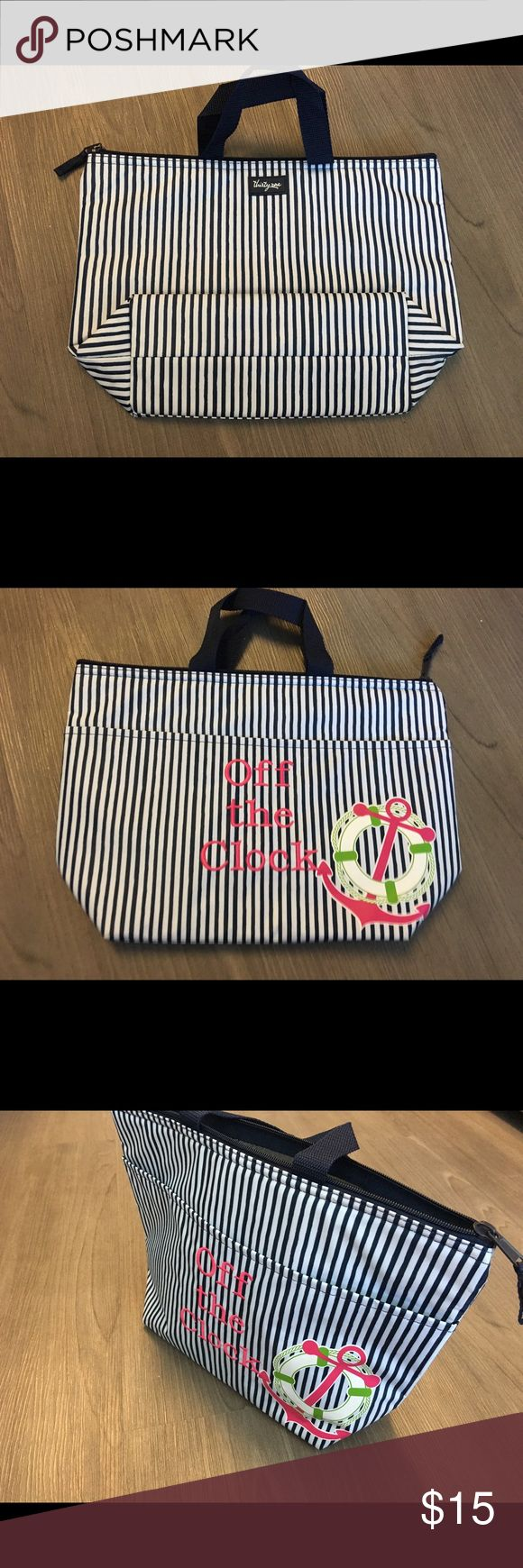 """Thirty-One Lunch Bag Thermal Brand new without tags Thirty-one thermal (lunch bag size).  This cute white and blue stripe design includes """"Off The Clock"""" embroidery on the front side. Thirty-One Bags"""