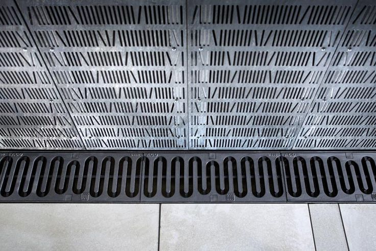 """Løbende Hund"", Drainage grate designed by JULIE KIERKEGAARD AS, produced by ACO Nordic AS. The grid/pattern continues around 90 degree corners"
