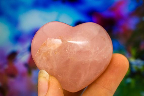 You will be receiving the exact specimen above, wrapped in colorful tissue and sprinkled with flower petals for its journey to you.  Called the Heart Stone, Rose Quartz may have been used as a love token as early as 600 B.C. and is still an important talisman of relationships. It is quite effective in attracting new love, romance and intimacy, or in developing a closer bond with family or friends. It supports connection within groups and community, and carries a high spiritual attunement to…