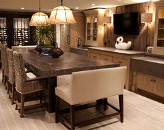 I love the idea of a long kitchen island that poses as a large dining room table!