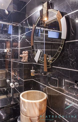Elegant design. Guests toilet cladded with Nero Marquina marble. Washstand of Onyx stone. Apartment in Bucharest, Romania.