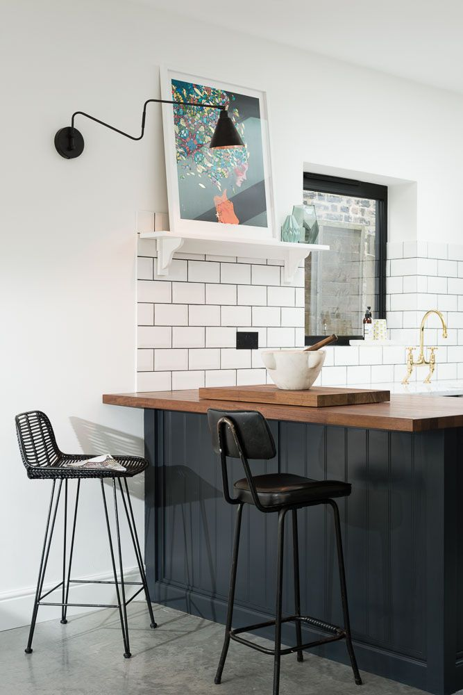 Tongue and groove panelled breakfast bar with an Iroko worktop