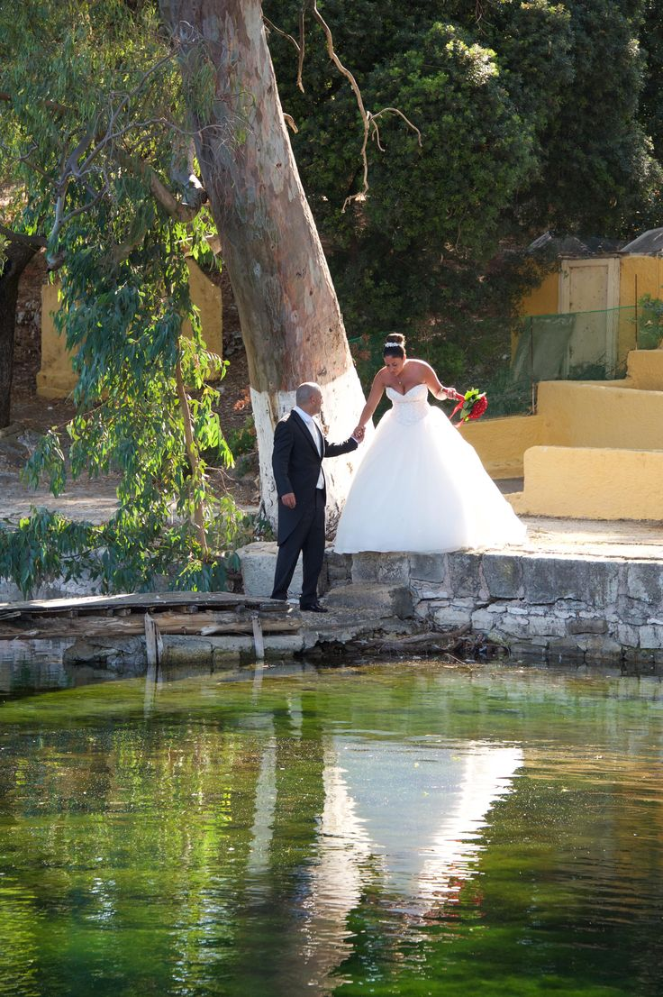 The protective groom is helping the woman who loves - Great shot with  the water reflection #weddingphotos #weddingingreece #mythosweddings #kefalonia