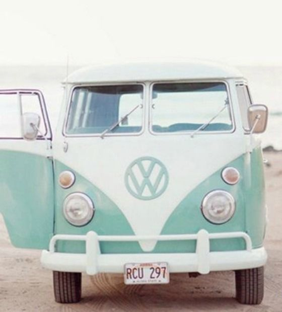 Arrive in style in a blue vintage VW van.