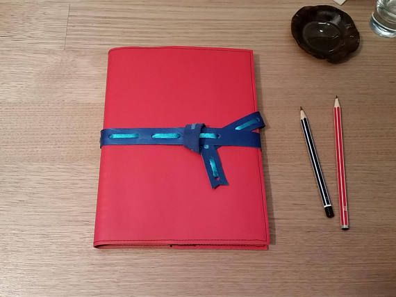 Check out this item in my Etsy shop https://www.etsy.com/au/listing/556143948/a5-leather-sketchbook-in-tomato-red