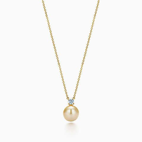 Tiffany South Sea pearl pendant in 18k gold with diamonds.